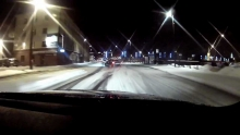 Snow drifting at night look like city of Kaunas
